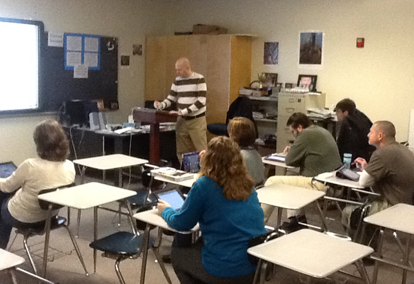 Mr. Anderson uses his iPad in class